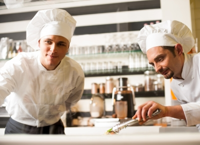 Chef Watching His Assistant Arranging Dish by stockimages ID-100276541